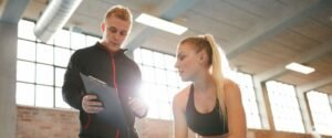 Personal Trainer with Client and Tablet - Virtuagym