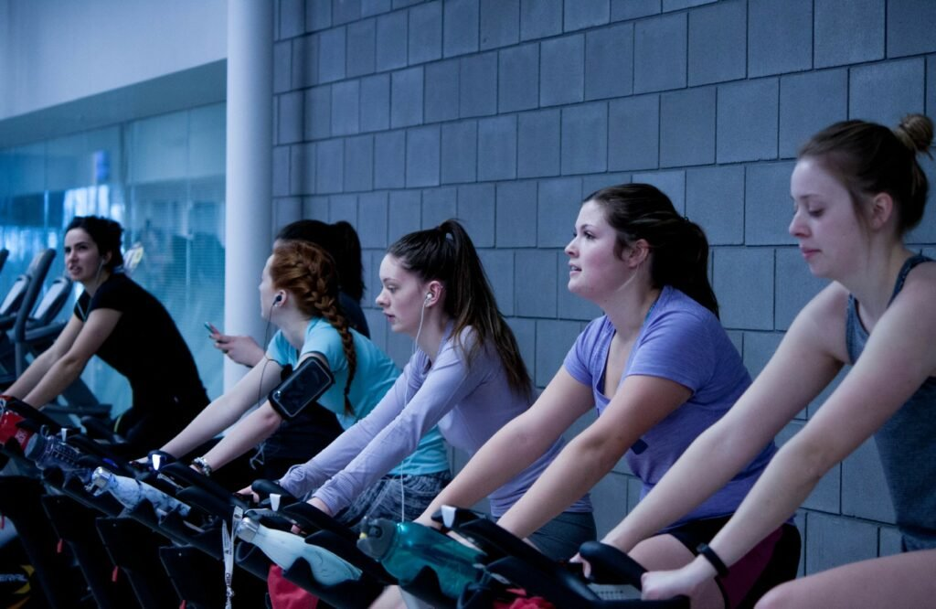 cycling indoors gym working out women fitness class