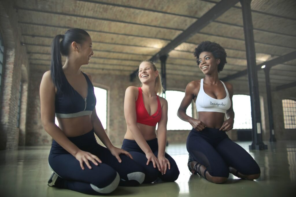 women laughing in a gym
