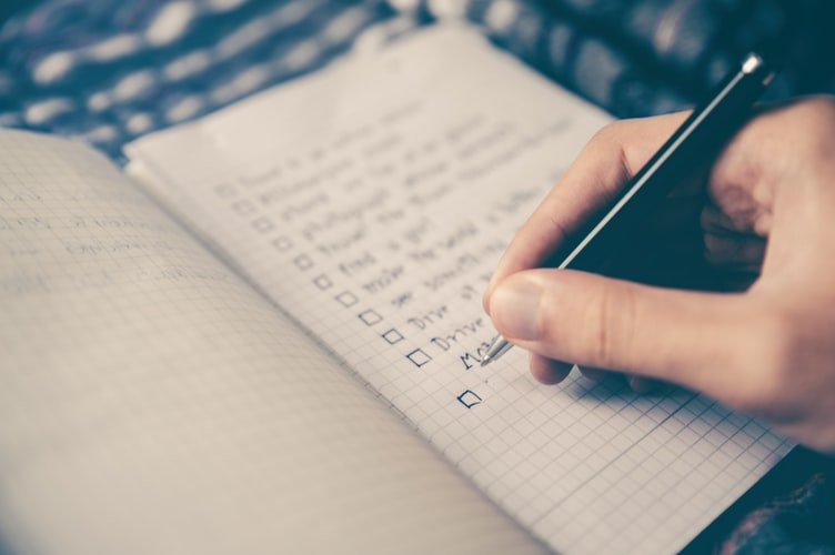 making lists in a notebook planning
